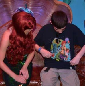 showing Ariel the shirt